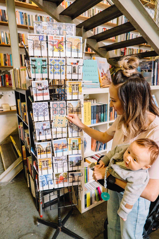 browsing for postcards at ler devagar