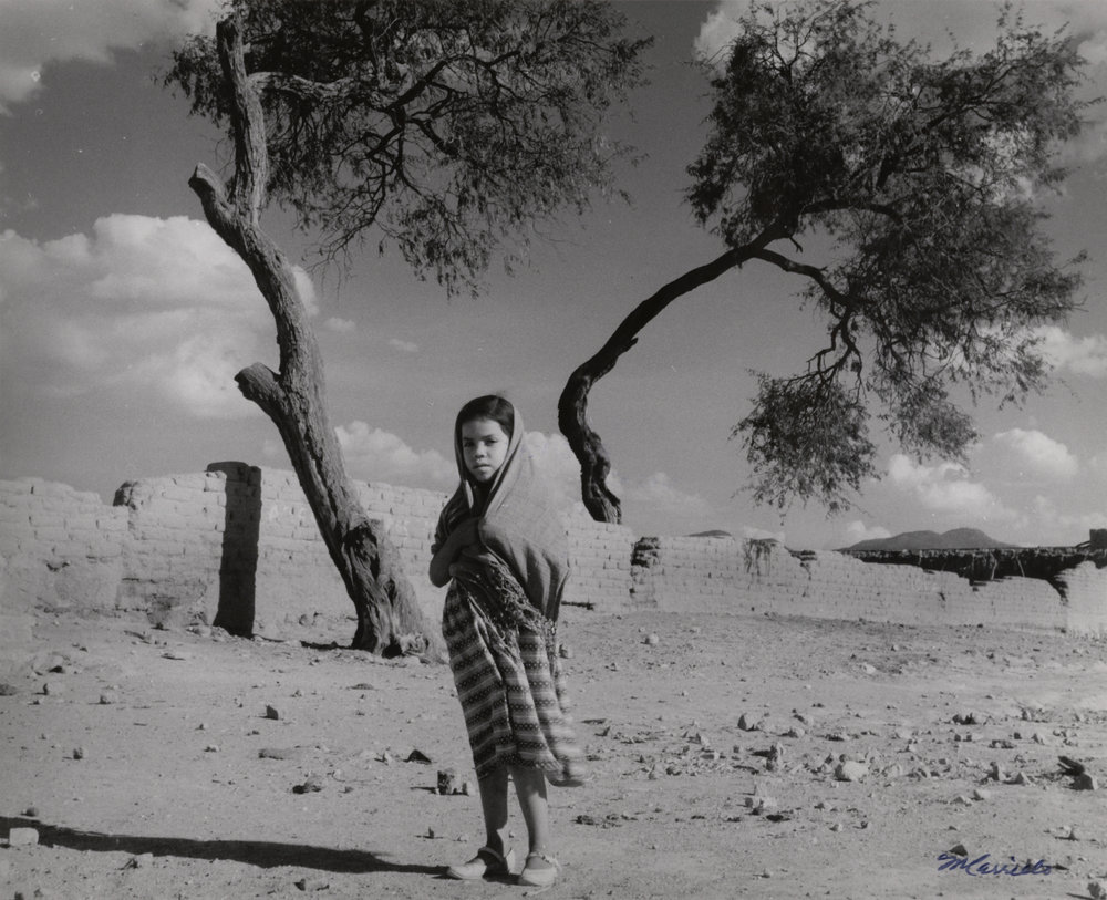 Girl Wearing Shawl in Walled Field , c. 1955-75. Black & White photograph on paper.8 x 10