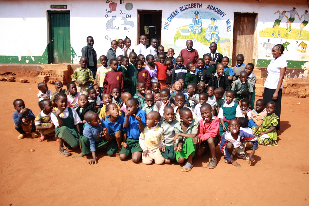 Here are the 65 students of the Queen Elizabeth Academy and their teachers in 2011, at this point sharing the local council buildings for lack of a building of their own.