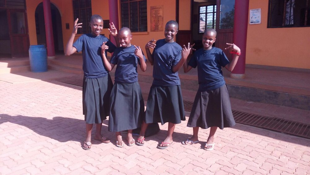 This is Lucia, Flora, Faith and Faraja, four members of the first ever nursery class at the Queen Elizabeth Academy. See if you can spot them in the 2011 picture above! They are now thriving as Form 2 students at  SEGA Girls Secondary School  in Morogoro, Tanzania.