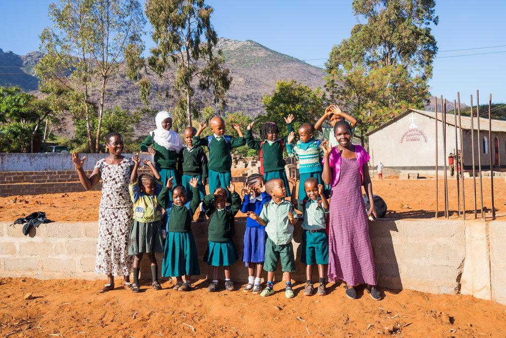 Teachers Kezia and Diana with their nursery class.
