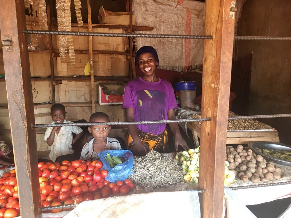Mama Isaya at her shop with her children