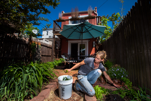 Meredith Sheperd, founder of Love & Carrots, working on an organic backyard garden. (Photo courtesy of Meredith Sheperd.)