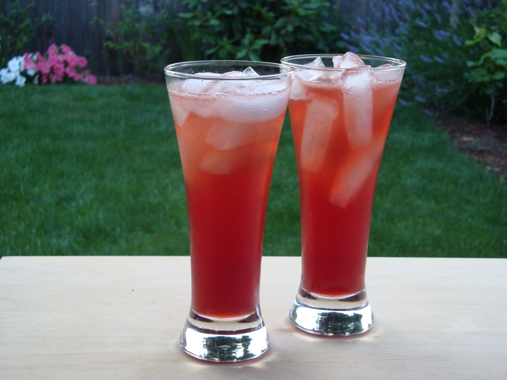 Mix lemon, hibiscus tea and Absolut Hibiscus,sweeten to taste. You're welcome.