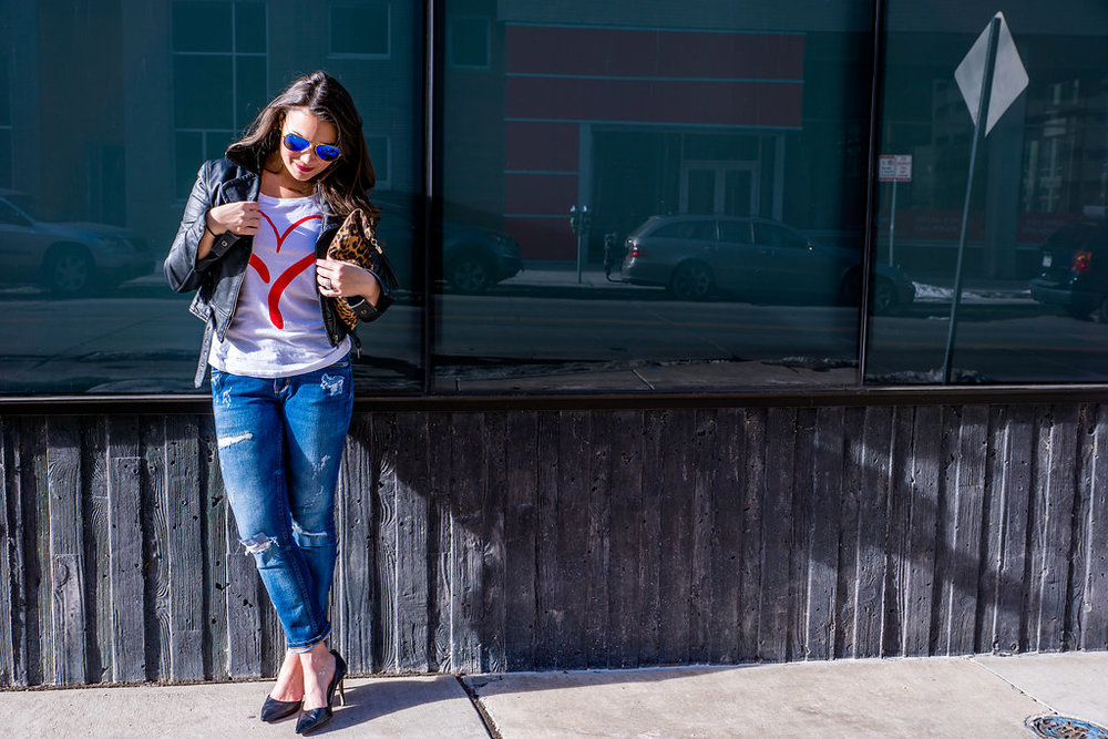 Heart graphic tee, leather jacket and distressed jeans supporting the American Heart Association and Go Red For Women