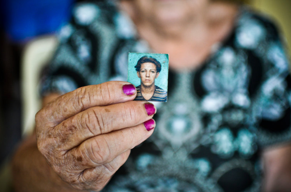 Francisca Ferreira Dr Vasconcelos showing a photo of her daughter, Dandara Dos Santos, 42, who was brutally killed in Brazil last month.(NYTIMES)