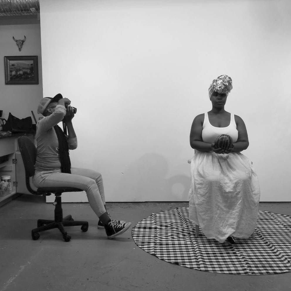 Shanequa Gay working with a model in her studio. Photo courtesy of the artist.