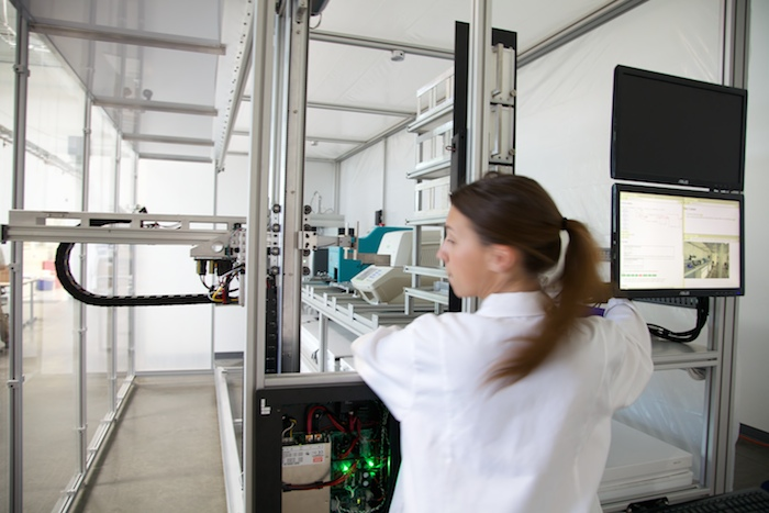 A robotic workcell undergoes testing.