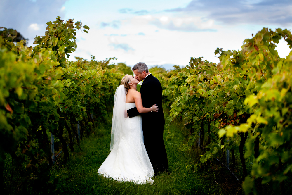 Married couple in the vines at Poachers Pantry, Canberra