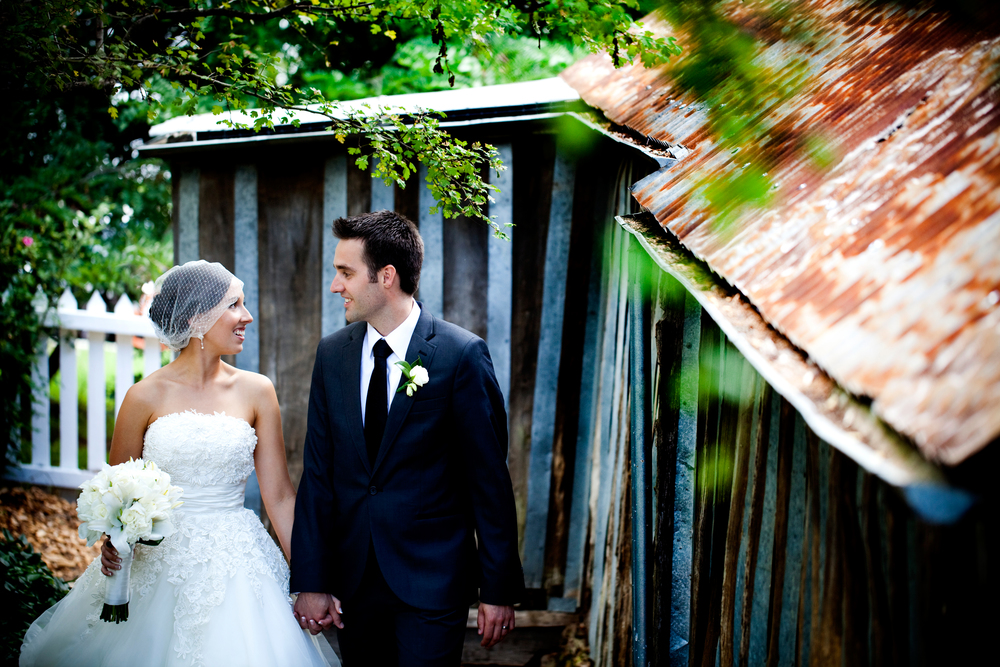 Wedding couple next to Blundells Cottage in Canberra