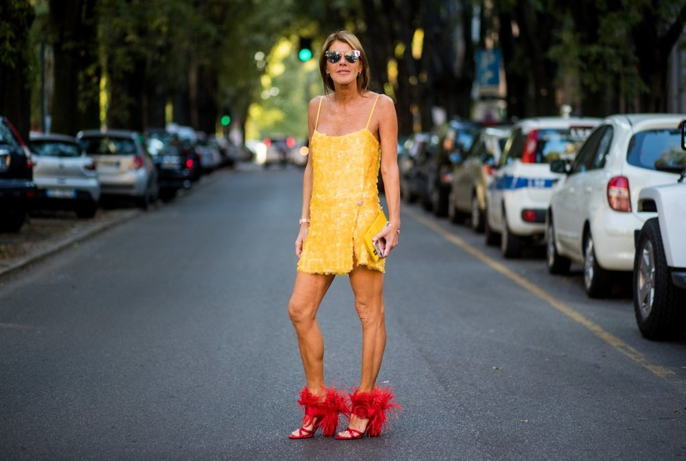Anna-Dello-Russo-didnt-play-safe-her-marigold-dress.jpg