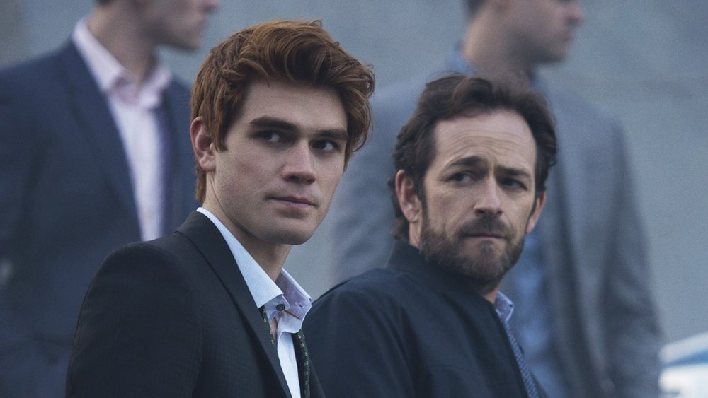 [Still image from  Riverdale  of KJ Apa as Archie and Luke Perry as Archie's father, neither of whom look like sophomores in high school.]