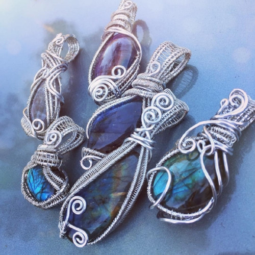 YOWZA - This stone is  crazy  gorgeous!  Check out these labradorite necklaces.