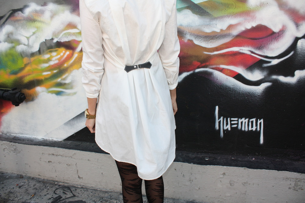 Amber shows us her secret to tailoring an oversized white shirt: add a buckle to the back. Photo by Laura Wise.
