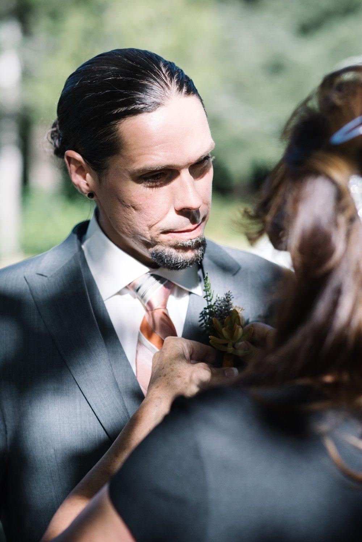 mom pinning groom