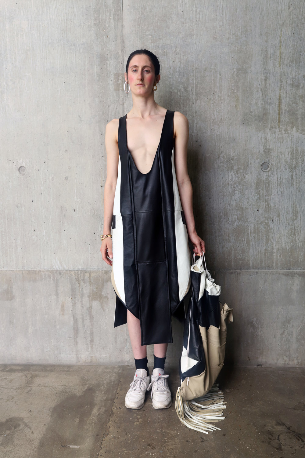 - Dress and oversized spike bag made from vintage leather jackets