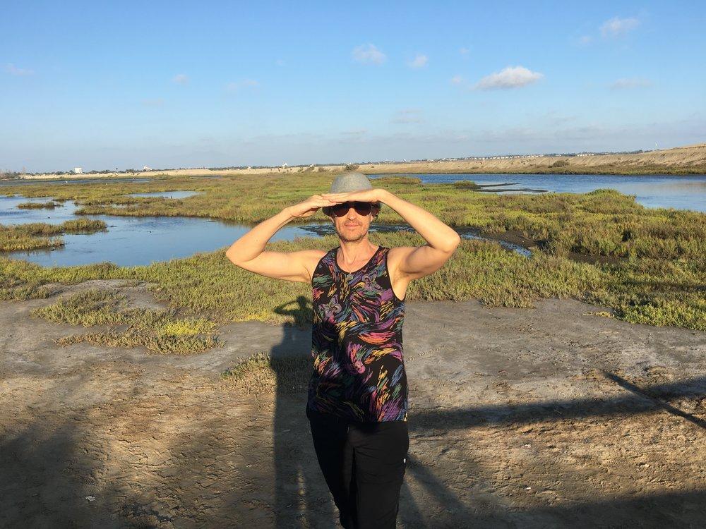 Alexander standing in the Bolsa Chica wetlands