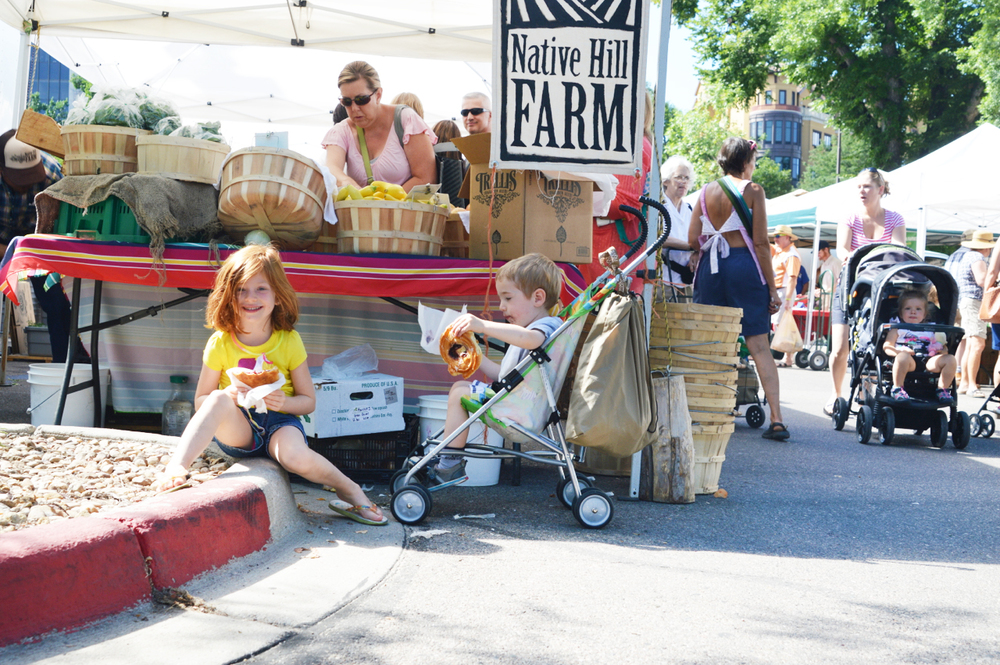 All smiles at the Farmer's Market! (Photo by Claire Burnett)