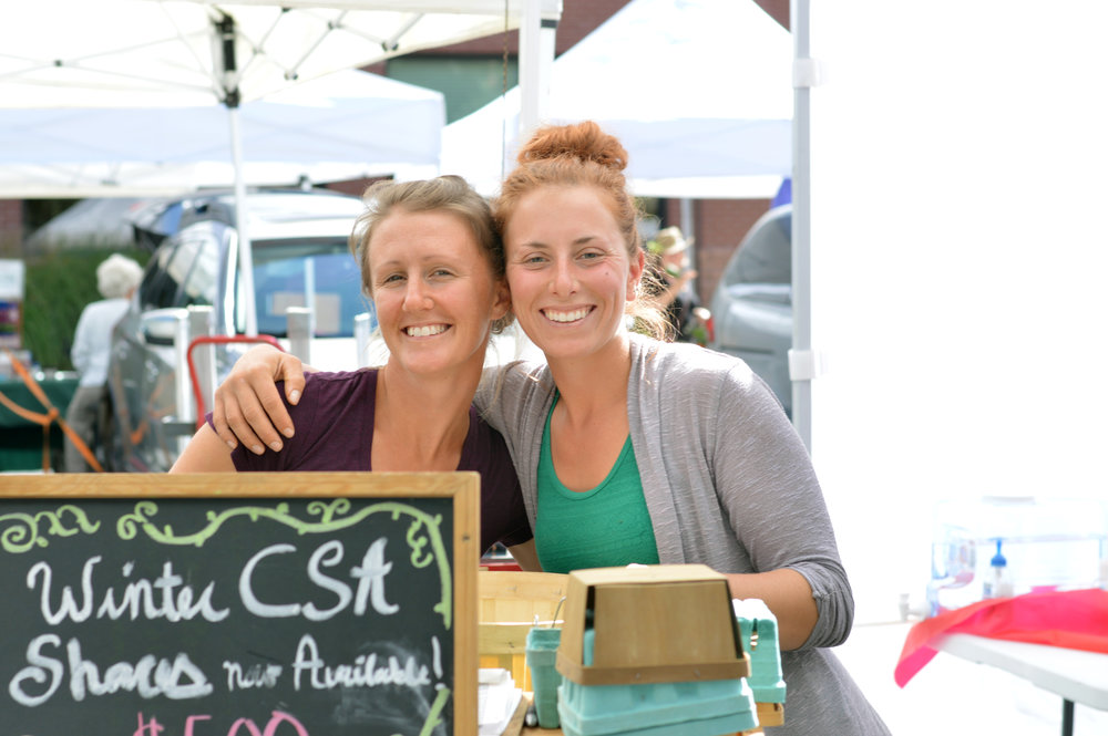 All smiles at the Larimer County Farmer's Market. (Photo by Cliff Cottage Collective)