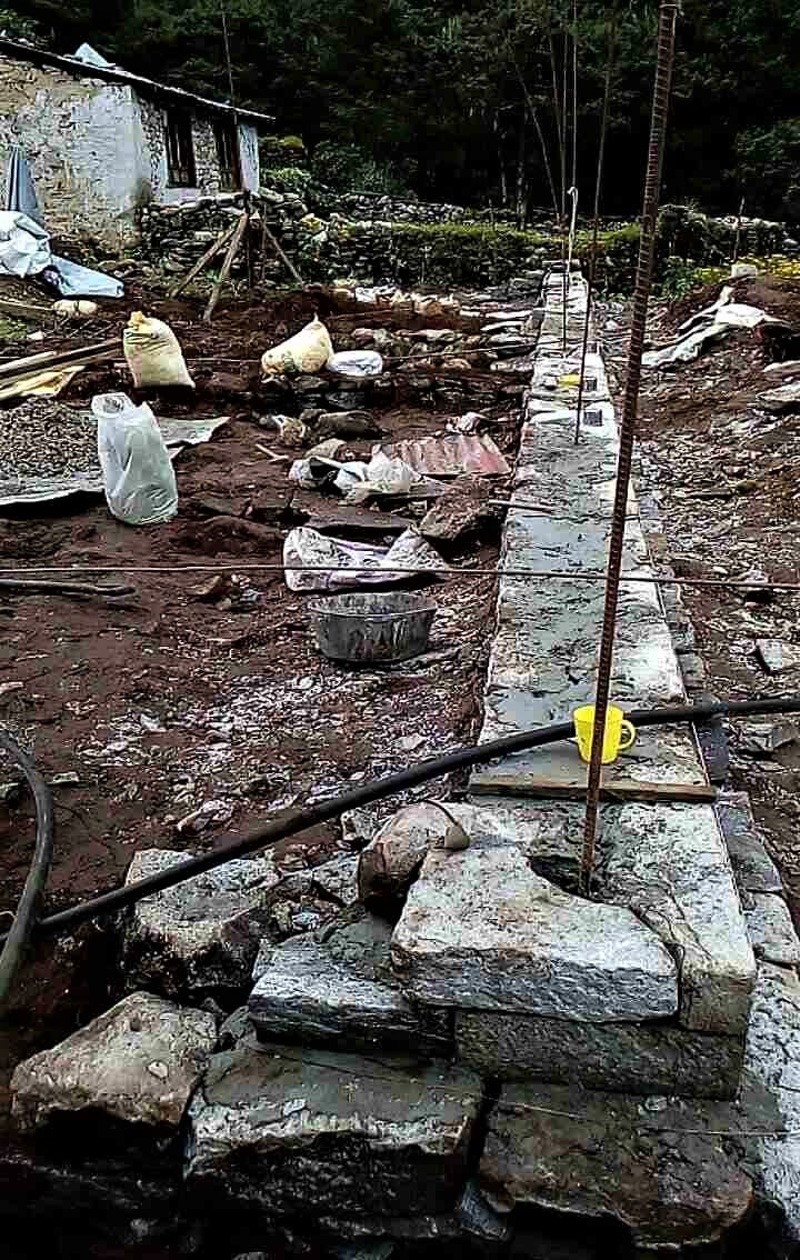 - Foundation wall in place with rebar.