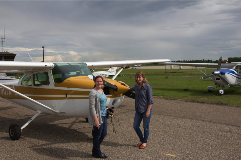 Dr. Emily Eaton and photographer Valerie Zink getting ready to fly over Lloydminster area to observe oil well density.