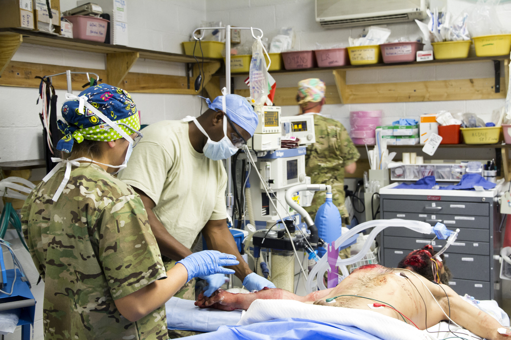 US Army medical personnel prepare a wounded Afghan soldier for surgery in the operating room at Forward Operating Base Farah (Farah, Afghanistan).