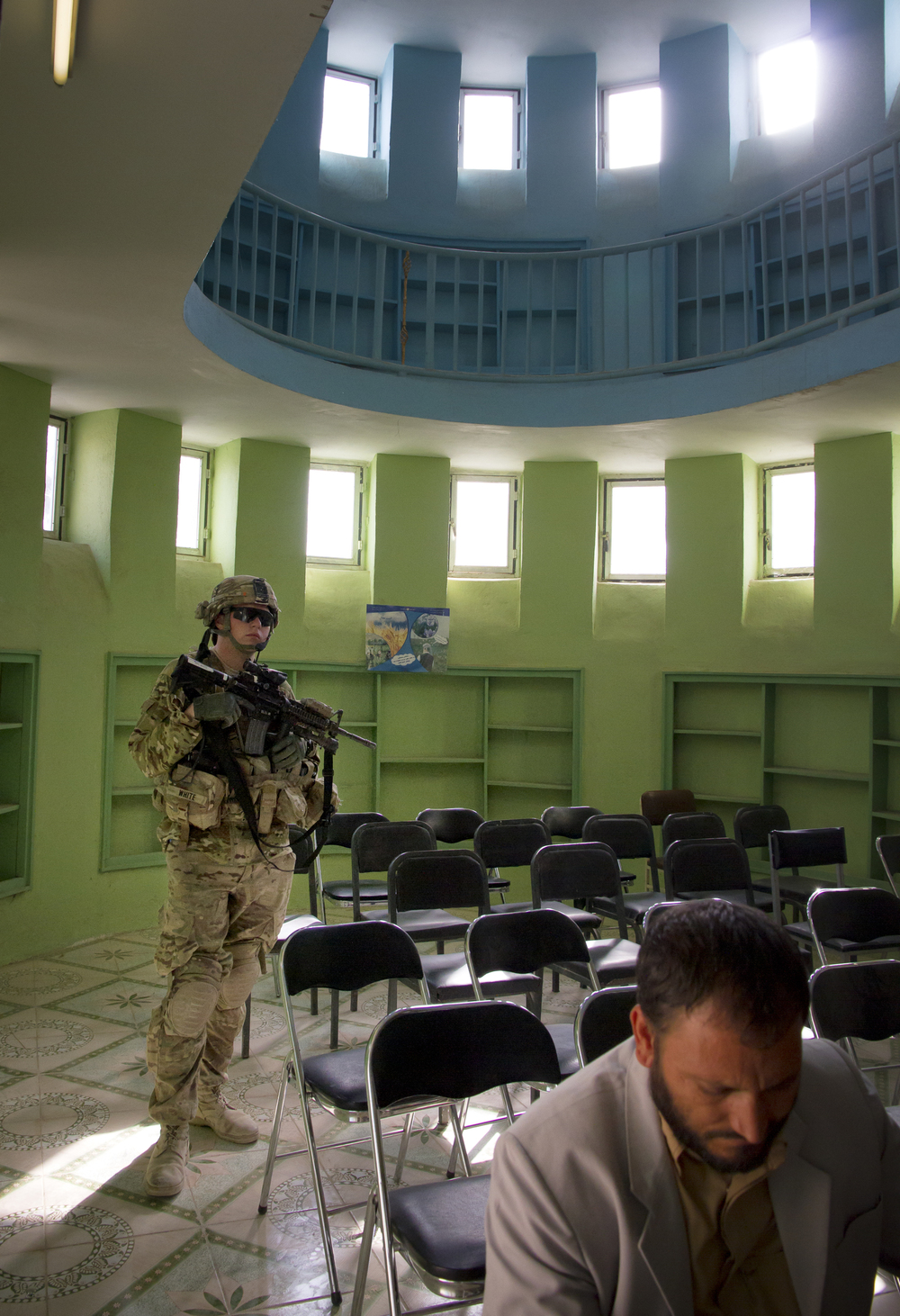 A US Army Soldier stands security inside the offices of the Director of Culture in Farah, Afghanistan.