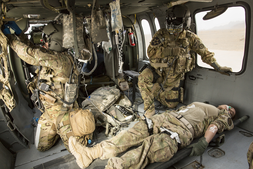 US Army flight medical personnel attend to a simulated casualty inside a blackhawk helicopter during training at Forward Operating Base, Farah, Afghanistan.
