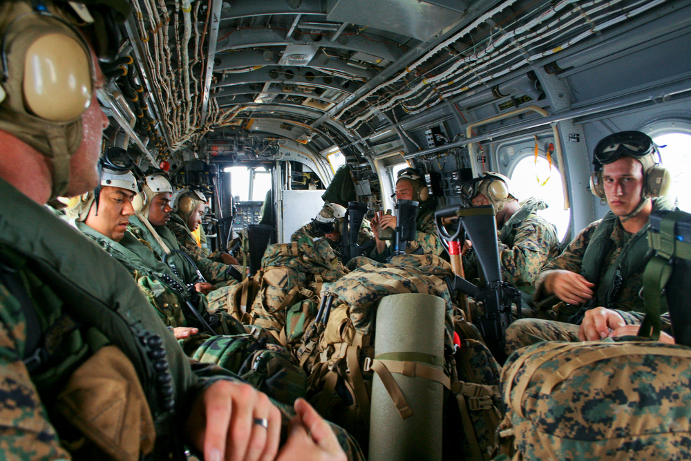 U.S. Marines and Navy medical personnel flying to the site of a massive landslide on the Island of Leyte, Philippines.