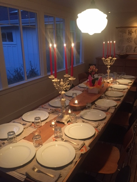The table is set, featuring Sara's candles.