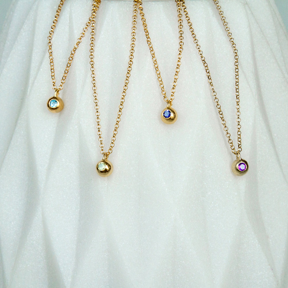 Mabel-Hasell---Gold-Orb-Necklaces-set-with-topaz,-peridot,-iolite-and-amethyst.jpg