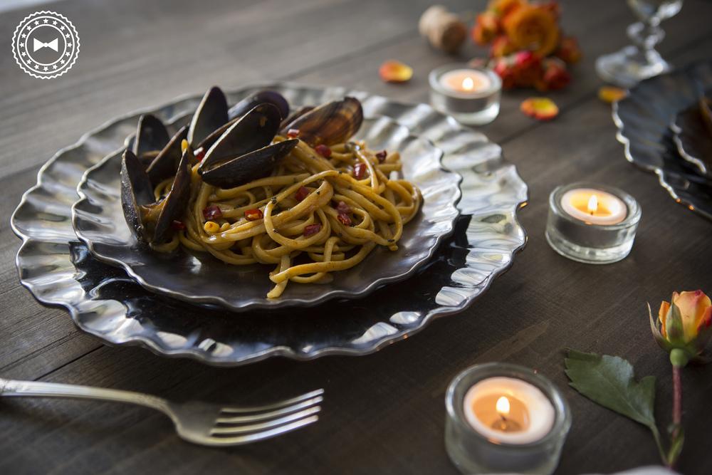 Mejillones sobre linguini en salsa cremosa de paprika y azafrán
