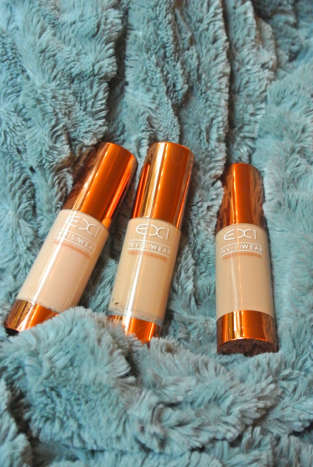 Ex1 Cosmetics Invisiwear Liquid Foundation. L to R: F100, F200, F300