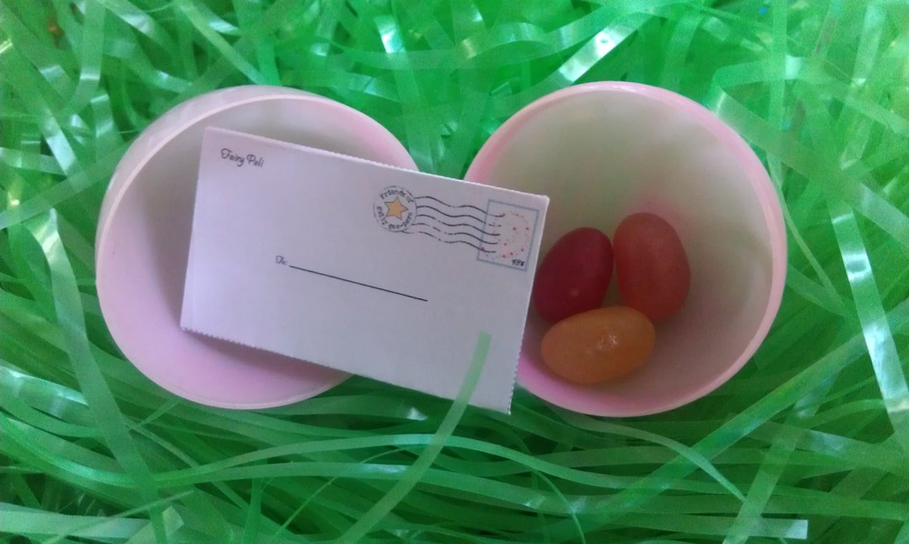 How about revealing the magic of kindness with a letter from Elf Raffi or Fairy Poli.Imagine your child opening an egg and finding this tiny little envelope. Inside is a letter. The writing is so small you have to use a magnifying glass to read it. What a whimsical delight for children and adults alike!  To create this experience for your child, go to our Freebies page.  There you will find instructions to download the  letter and envelope template. You can choose Fairy Poli for girls or Elf Raffi for boys. Have fun!