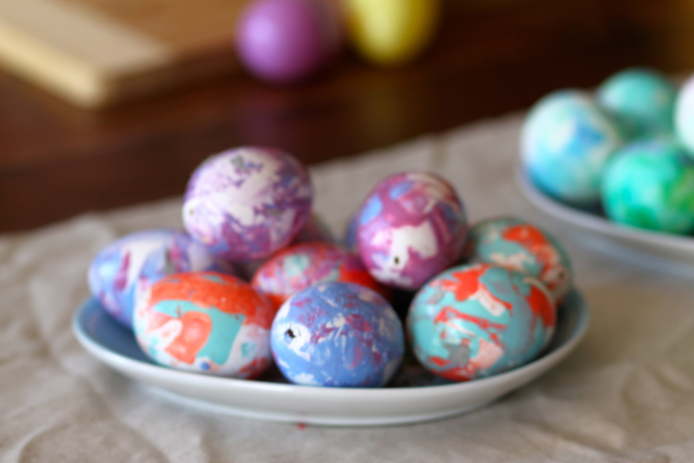 These eggs were blown out and dyed with nail polish! Just put drops of various nail polish colors in luke warm water and roll your egg along the surface. Use gloves and crack a window for the smell :p