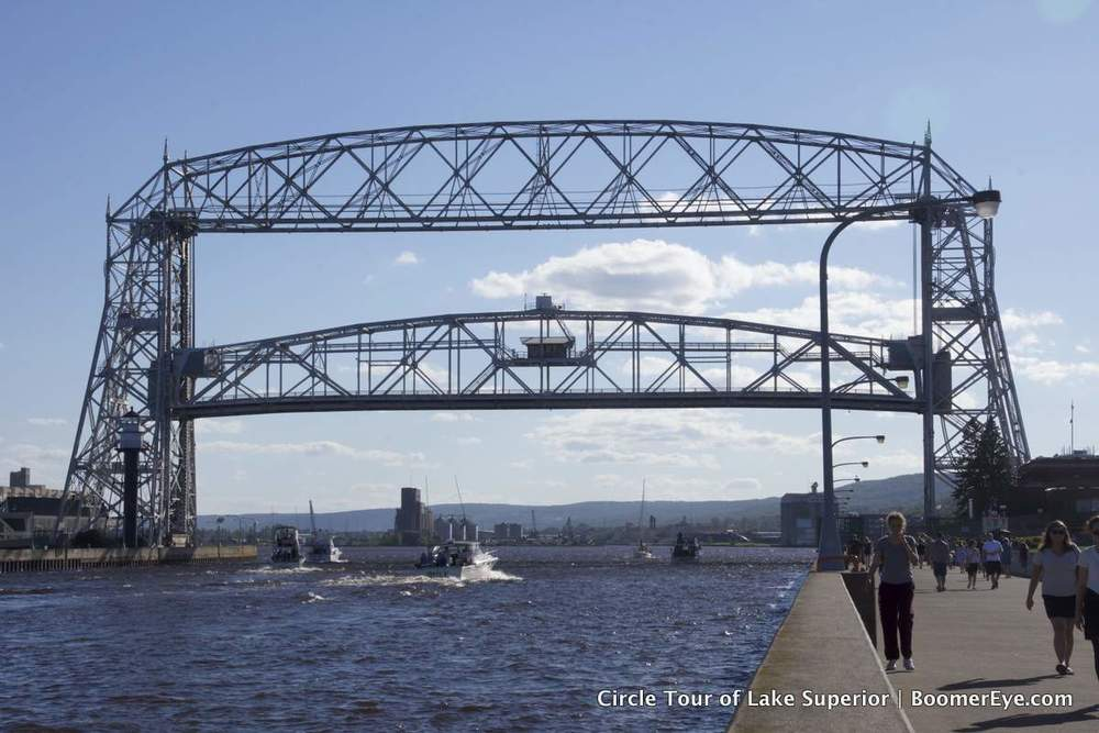 "Duluth's Aerial Lift Bridge goes up when boats / ships come in to the harbor that are too tall. I have always loved that bridge. I use to watch ships go under it and wonder what the people ON them saw ""out there."" They were perhaps my first tangible introduction to a bigger world."