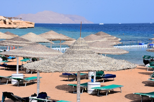 BEACH PERFECTION in SHARM EL SHEIKH   Domina Resort at Coral Bay in Sharm El Sheikh (Isle of Tiran in distance) has beautiful beaches accented by alluring water,  incredible coral and fish to enjoy while swimming, snorkeling and diving. Photo © Mary Lascelles / BoomerEye