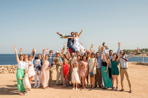 "THE BRIDE AND GROOM, CAMEL, and GUESTS We couldn't just let the white camel leave without getting a shot of Bride AND Groom on top with guests celebrating after they'd said their ""I Do's""... What a great day in Sharm El Sheikh!  Photo © Mary Lascelles / BoomerEye"