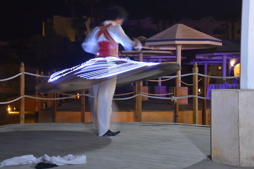 "THE TWIRLER Part of the evening's entertainment after the wedding was watching this fellow ""twirl"". He  was extremely adept at it. It must be amazing for your sense of balance to keep up the practice!  I almost needed some Dramamine simply watching.  Photo © Mary Lascelles / BoomerEye"