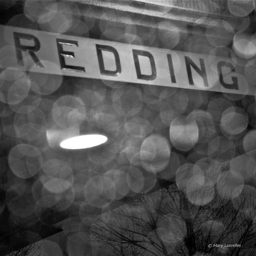 Redding Rain - (square format, black and white version) The black and white version of 'Redding Rain' has been one of my most popular images over time. I found myself waiting for my son at the Redding Amtrak station int he middle of a rainy night. I looked up through my windshield and saw this marvelous sight. I'm so glad I thought to pick up my camera and play with those rain drops!