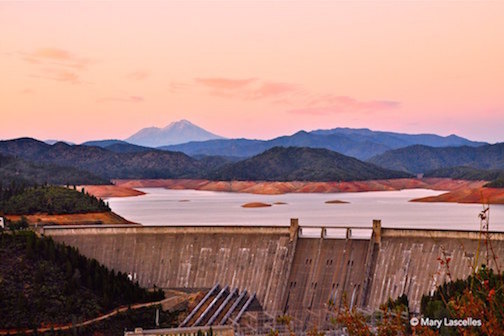 The 3 Shastas - © Mary Lascelles (rectangular format, color version) Taken in the autumn of 2014, this was before the rains returned and the water level was down a bit. What a sight to behold! Mt. Shasta, Shasta Dam, and Lake Shasta.
