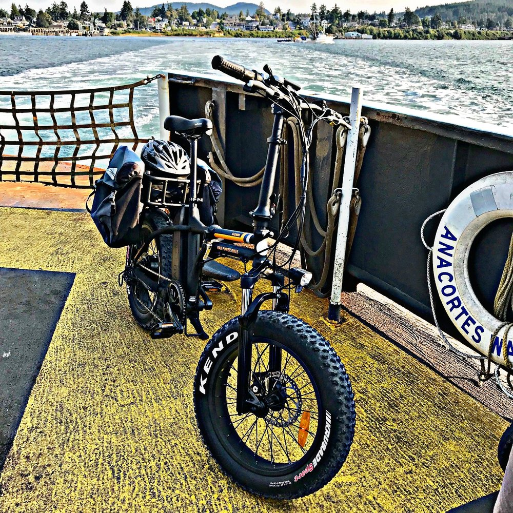 "RAD MINI FAT BIKE on the GUEMES FERRY   Is that the coolest sight? This is ""his"" bike (mine is white) but these bikes are now our mode of transport from home to the ferry and from the ferry to wherever across the Guemes Channel - not every time but frequently. It makes good sense and it's fun!"
