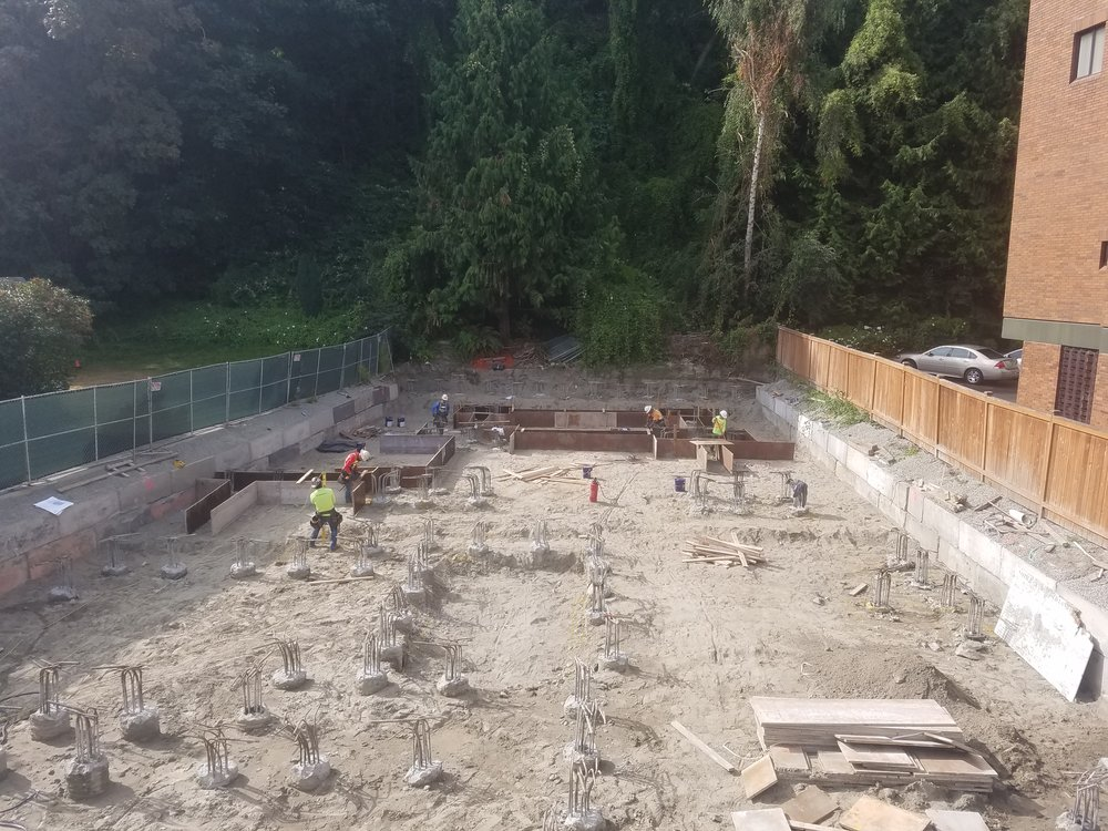 Foundation forms going in. Footings an Grade beams are all tied together with the auger cast piles.