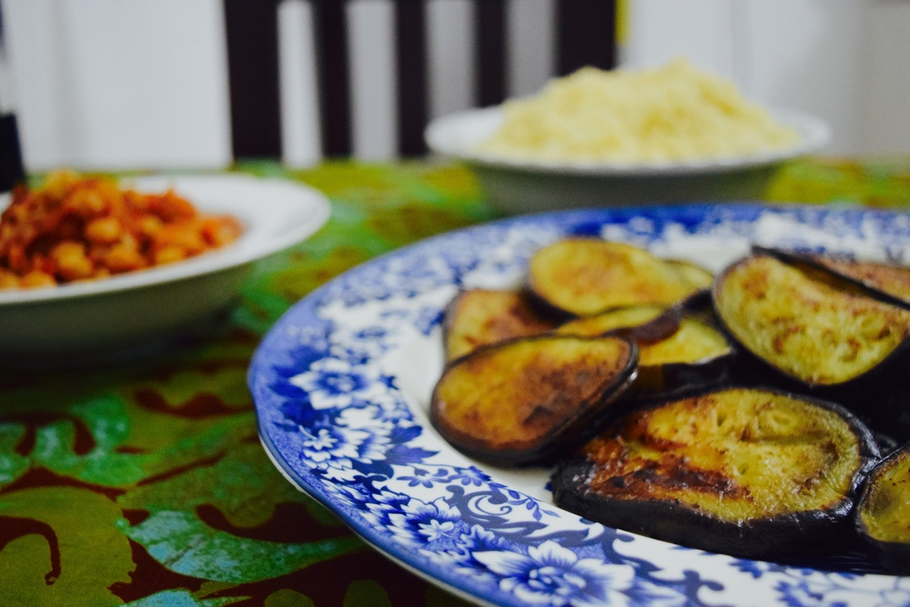 Fried eggplant accompanied by chickpeas in a tomato-onion berbere sauce