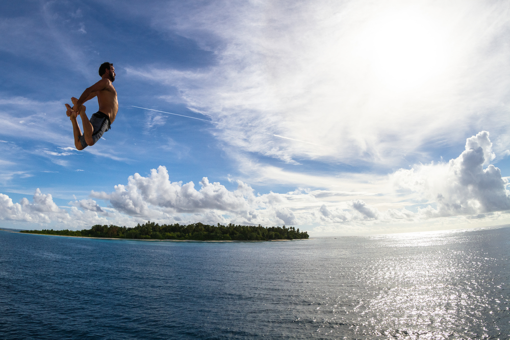 Launching off the boat's rooftop, Menatawai Islands, Indonesia