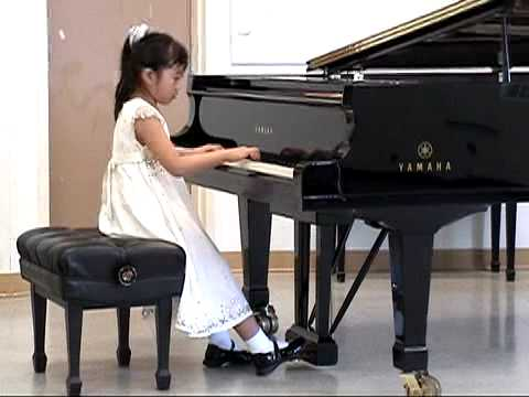 Pianist playing a grand piano
