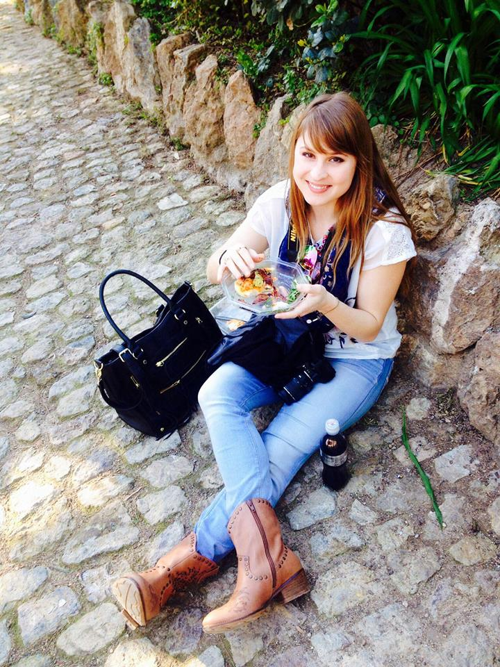 This is me eating a cheap meal on the ground in Barcelona because it saved time and money. I often pack food in my purse to save money throughout the day.