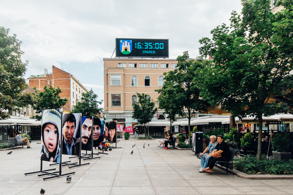 A common outdoor lounging area near the shops and restaurants displays a beautiful installation of refugees' portraits. In the comments below, I have typed the artist's statement of this installation if you're curious.   Behind me in the photograph was another line of portraits and on the other side of the photographs you see are other portraits so this is only 1/4 of the entire installation.
