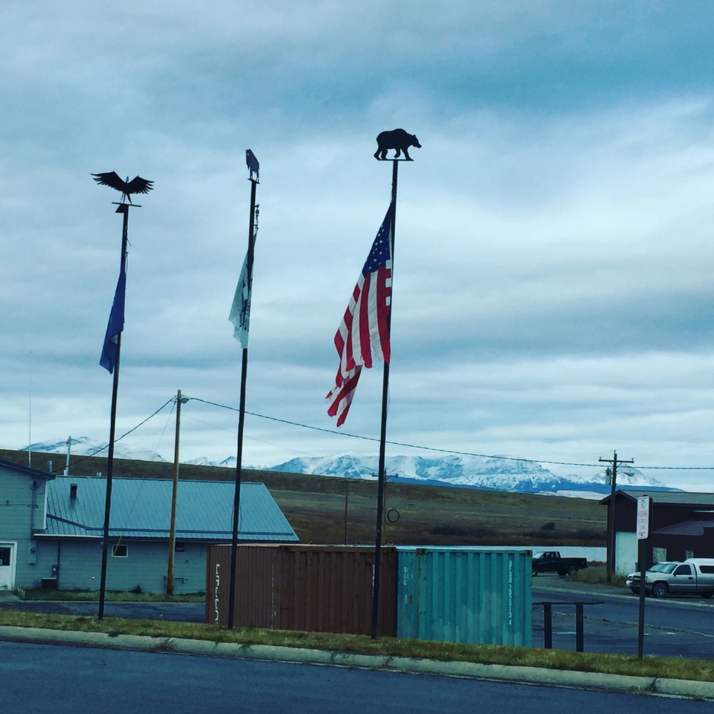 The federal, state, and tribal flags represented on the Blackfeet reservation