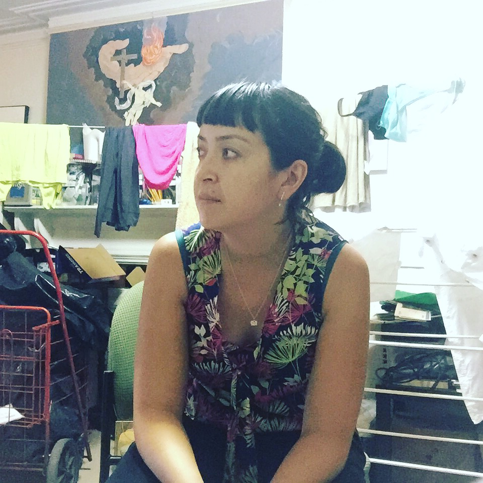 Earlier last week with another impromptu legal office: the sitting room of the house I'm living at in the South Bronx. A couple different women who live nearby came over to talk about their immigration claims. Here's to providing legal services from wherever -- clothes drying in the background and all.